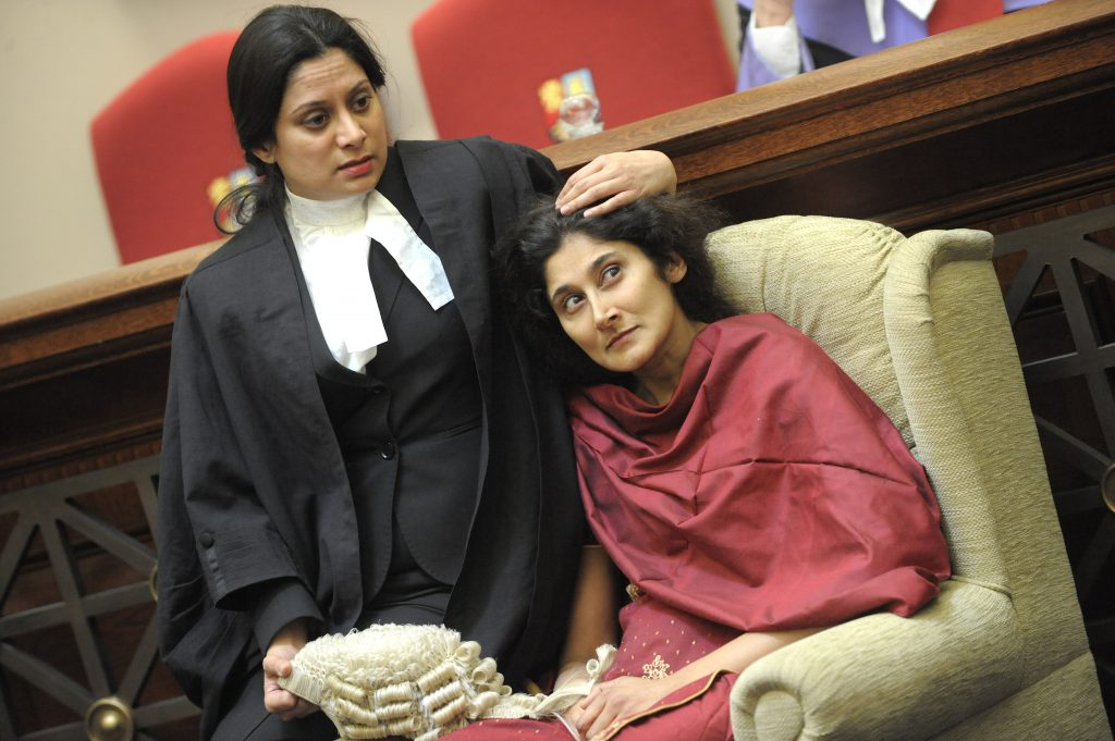 a barrister comforting her client