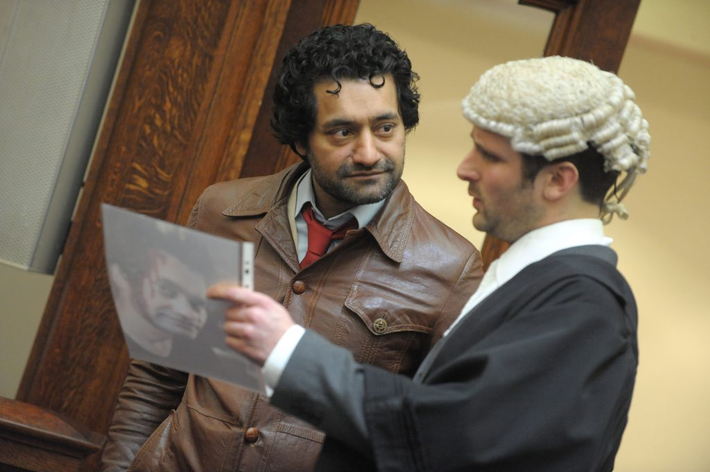 a barrister talking to a man