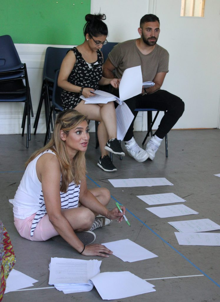 writer with script and actors