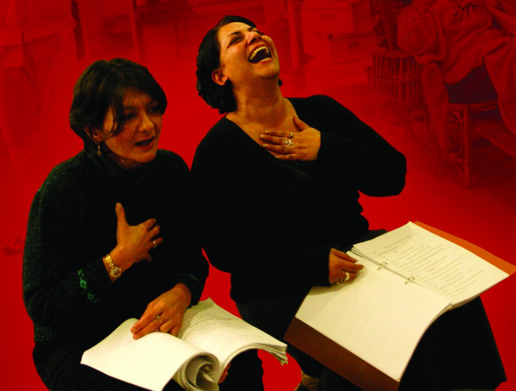 two actors with scripts laughing